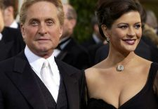 """(FILES) Actors Michael Douglas (L) and his wife Catherine Zeta-Jones arrive for the 60th Annual Golden Globe Awards 19 January, 2003, in Beverly Hills, California. Douglas has admitted his throat cancer is more serious than first thought, but says he remains optimistic as he undergoes intensive treatment.""""It's a stage four, which is intense, and they gotta go at it,"""" Douglas told chat show host David Letterman on the """"Late Show"""" August 31, 2010. Douglas, 65, who is married to another Hollywood A-lister, British actress  AFP PHOTO/Lucy NICHOLSON (Photo credit should read LUCY NICHOLSON/AFP/Getty Images)"""